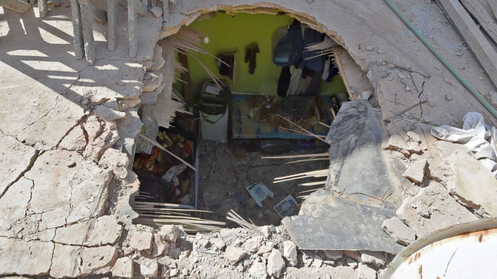 In the Um Al-Hammam district in Riyadh shows the pierced ceiling of a home hit by falling shrapnel from Yemeni rebel missiles that were intercepted over the Saudi capital, March 26, 2018.