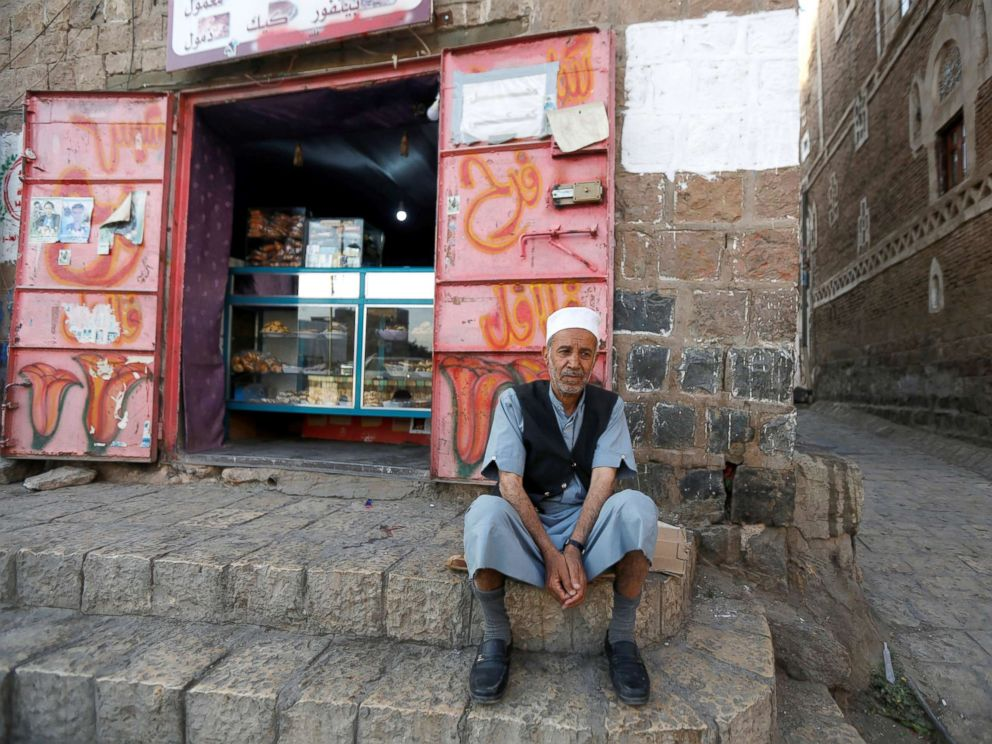 PHOTO: Lutf Ali al-Shahari sits on a pavement in Sanaa, Yemen, March 24, 2018. Life in a time of war is tragedy, injustice, and destruction of houses and roads. Also, food is barely entering the country. Prices are high, he said.