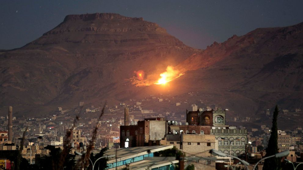 In this Oct. 14, 2016 file photo, fire and smoke rise after a Saudi-led airstrike hit a site believed to be one of the largest weapons depots on the outskirts of Yemen's capital, Sanaa.