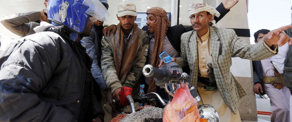 PHOTO: Yemenis argue as an attendant pumps fuel into a motorbike at a petrol station amid fuel shortages in Sanaa, Yemen, Nov. 9, 2017.