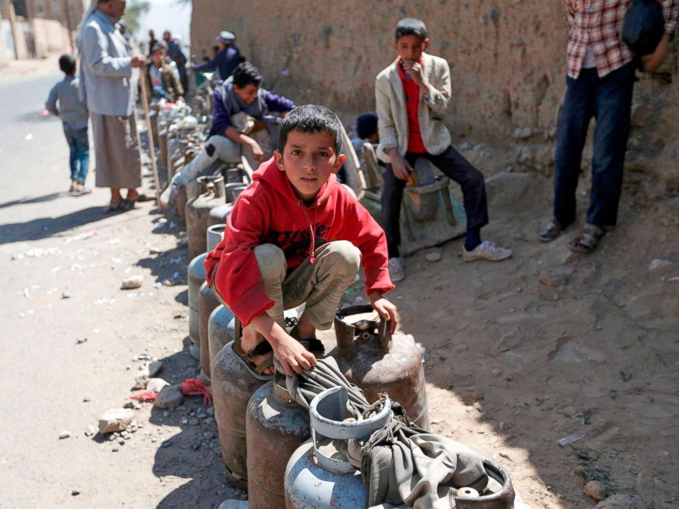 PHOTO: Yemenis wait next to empty gas cylinders for gas supplies amid increasing shortages in the Yemeni capital Sanaa, on Nov. 9, 2017.