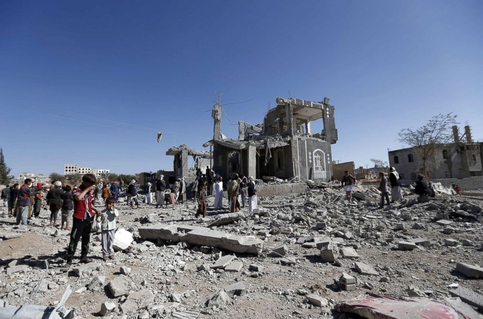 PHOTO: Yemenis check the damage in the aftermath of a reported air strike by the Saudi-led coalition in the Yemeni capital Sanaa, March 8, 2018.