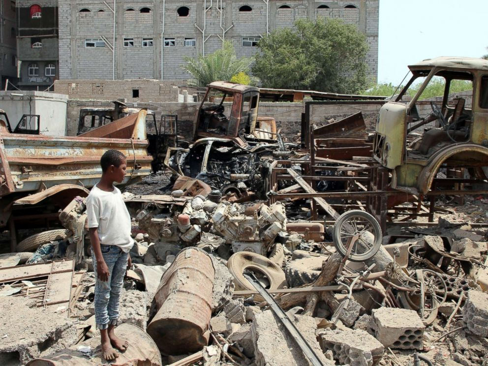 PHOTO: A boy is seen on the site after a car bomb ripped through a military kitchen in Aden, Yemen, March 13, 2018.