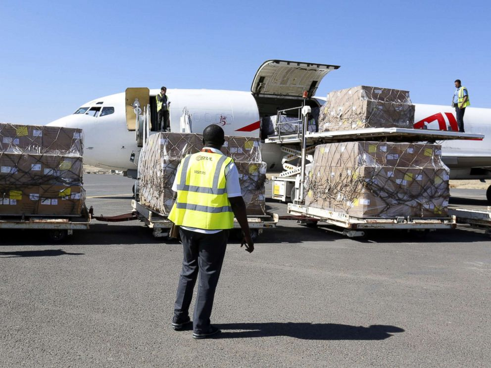 PHOTO: Workers unload emergency medical aid of 1,9 million doses of vaccines supplied by UNICEF at Sanaa International Airport after it was reopened to UN humanitarian air flights, in Sanaa, Yemen, Nov. 25, 2017.