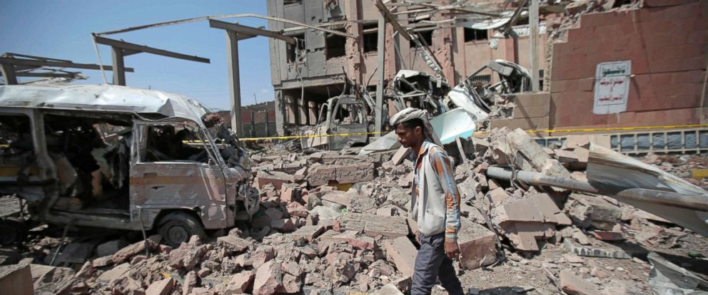 PHOTO: A man inspects rubble after a Saudi-led coalition airstrike in Sanaa, Yemen.