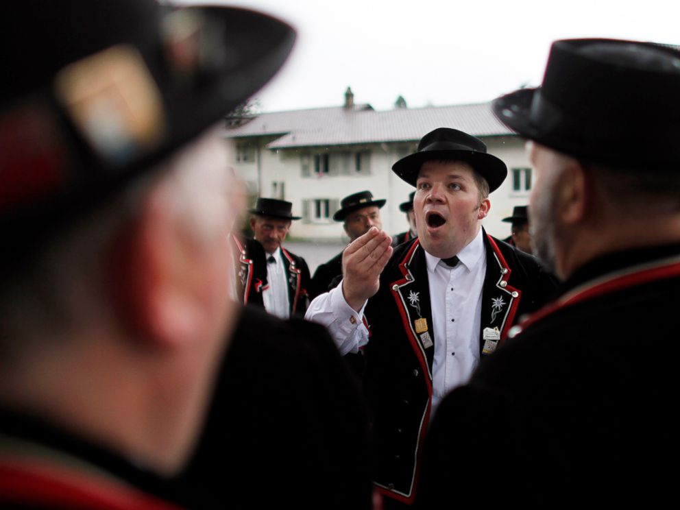 PHOTO: Yodelers dressed in traditional Swiss costumes perform at the 28th Federal Yodelling Festival in Interlaken, Switzerland, June 18, 2011.