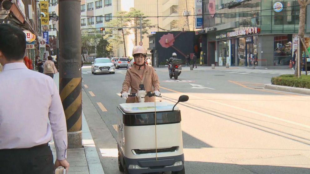 PHOTO: South Koreas yogurt ladies ride motorized fridges to fulfill your dairy needs.