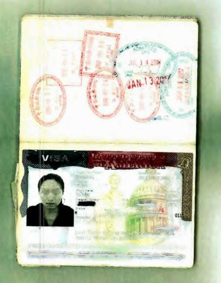 A passport photo of Yujing Zhang, alleged Mar-a-Lago intruder, was entered into evidence during a pre-trial hearing in Florida.