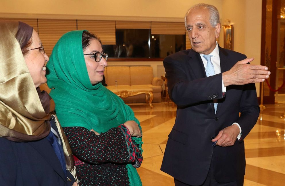 PHOTO: US Special Representative for Afghanistan Reconciliation Zalmay Khalilzad speaks with Asila Wardak during the Intra Afghan Dialogue talks in the Qatari capital Doha on July 8, 2019.