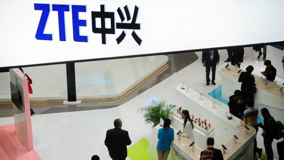 In this Wednesday, Feb. 26, 2014, file photo, people gather at the ZTE booth at the Mobile World Congress, the world's largest mobile phone trade show in Barcelona, Spain.