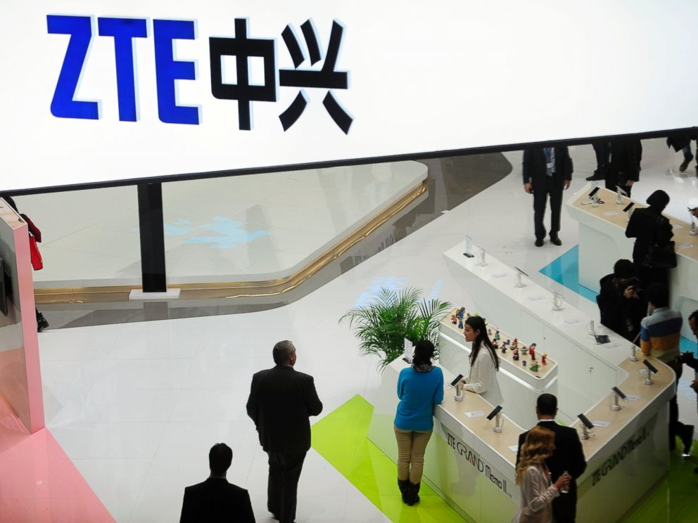 In this Wednesday, Feb. 26, 2014, file photo, people gather at the ZTE booth at the Mobile World Congress, the worlds largest mobile phone trade show in Barcelona, Spain.