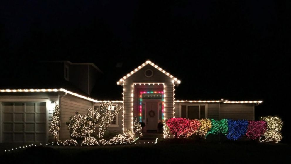 reputable site 6d971 56226 Woman Hangs Rainbow Christmas Lights to Protest Allegedly ...