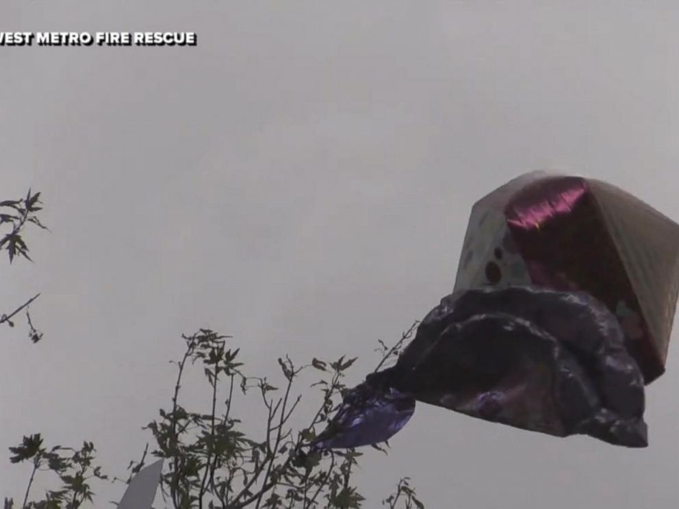 Firefighters help rescue little boys card tied to balloon to deceased mom in heaven.