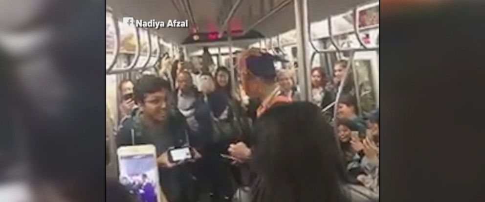 College student who got stuck on a subway train while heading to his graduation is thrown an impromptu ceremony by fellow riders.