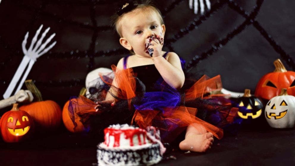 Strange Baby Celebrates 1St Birthday With Creepy Halloween Cake Smash Funny Birthday Cards Online Barepcheapnameinfo