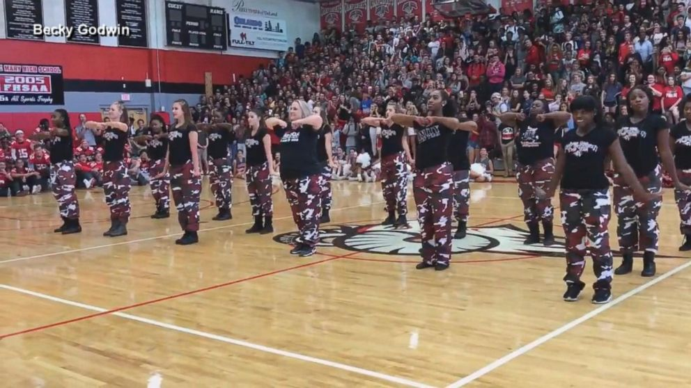 Principal surprises students by joining step team at pep rally