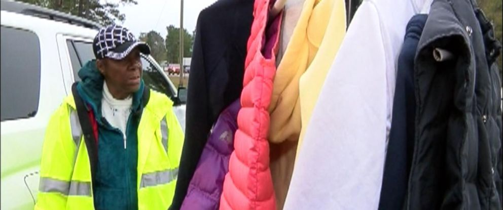 VIDEO: Minnie Galloway set up a coat rack in her usual post near Trask Middle School in North Carolina.