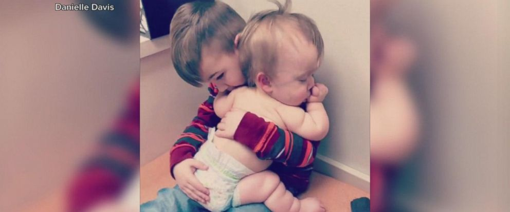 VIDEO: Big brother comforts sick baby sister in adorable video