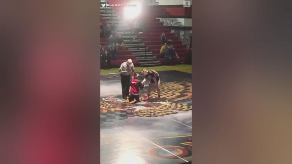 VIDEO: A high school student is being commended for an extraordinary act of sportsmanship, going to the mat in a wrestling match against a younger opponent with a physical disability.