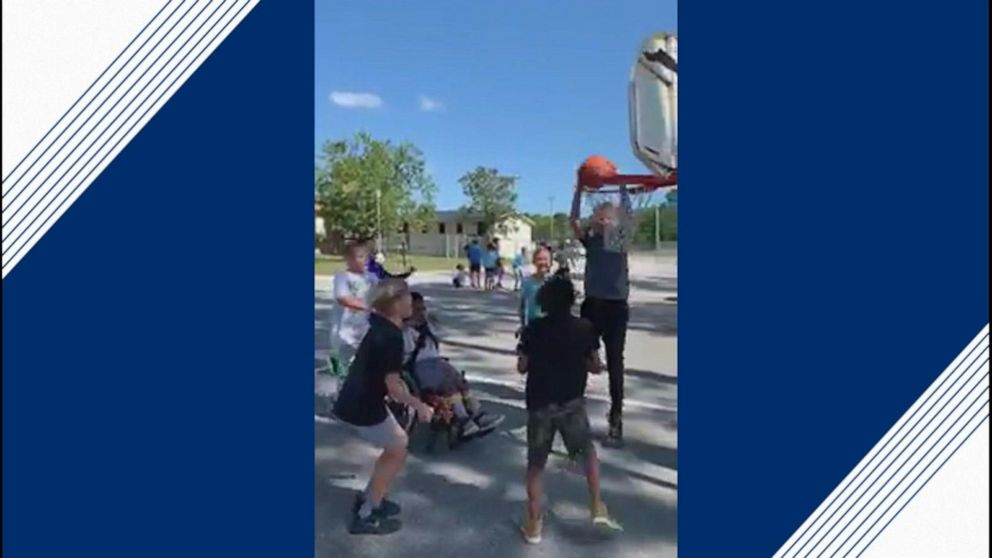5th graders play hoops with student in wheelchair in sweet video