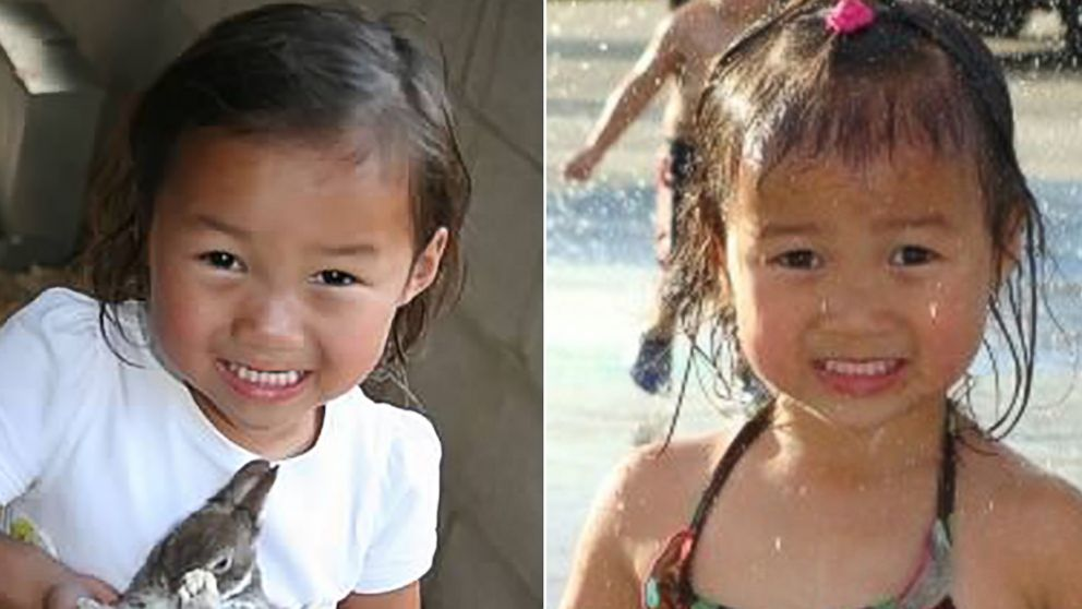 The two share a similar smile. Audrey Doering, pictured left at age 4, holds a bunny, and Gracie Rainsberry, pictured right at age 3, plays in a fountain.