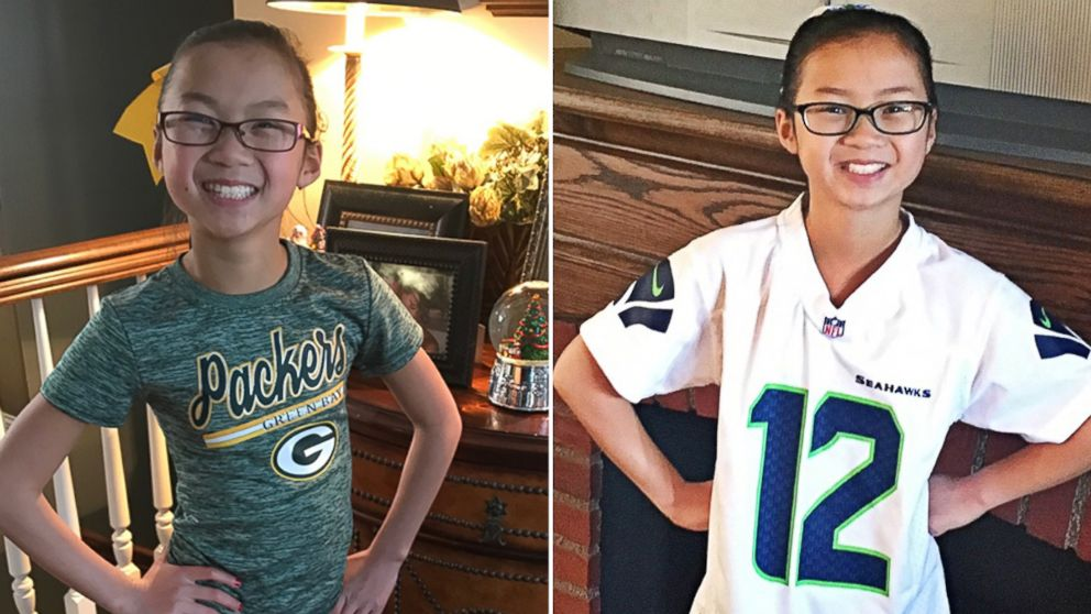Audrey Doering, 10, pictured left, sports her beloved Green Bay Packers gear, and Gracie Rainsberry, 10, pictured right, wears a Seahawks jersey.