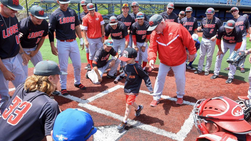 Lio Ortega, a 4-year-old cancer patient, runs the bases during a recent college baseball game in El Paso County, Colo.