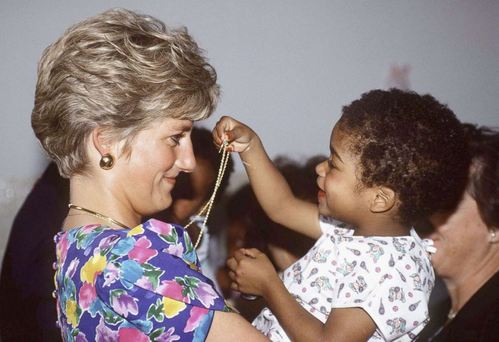 PHOTO: Princess Diana, Princess of Wales is seen cuddling a child during a visit to a hostel for abandoned children many of whom are HIV positive or suffer from AIDS on April 24, 1991, in Sao Paolo, Brazil.