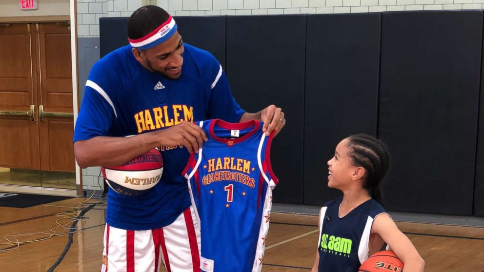 Karis also gained the attention of the Harlem Globetrotters, one of whom surprised her on the court today with her own personal jersey.
