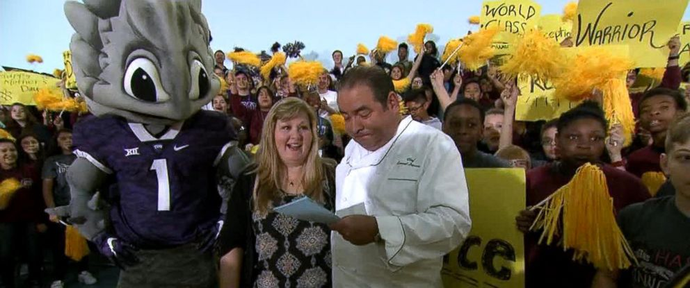 "PHOTO: Emeril Lagasse named Lea Siegel, an educator from Fort Worth, Texas, the winner of his annual ""Breakfast in Bed"" search before leading her into the schools auditorium filled with students."