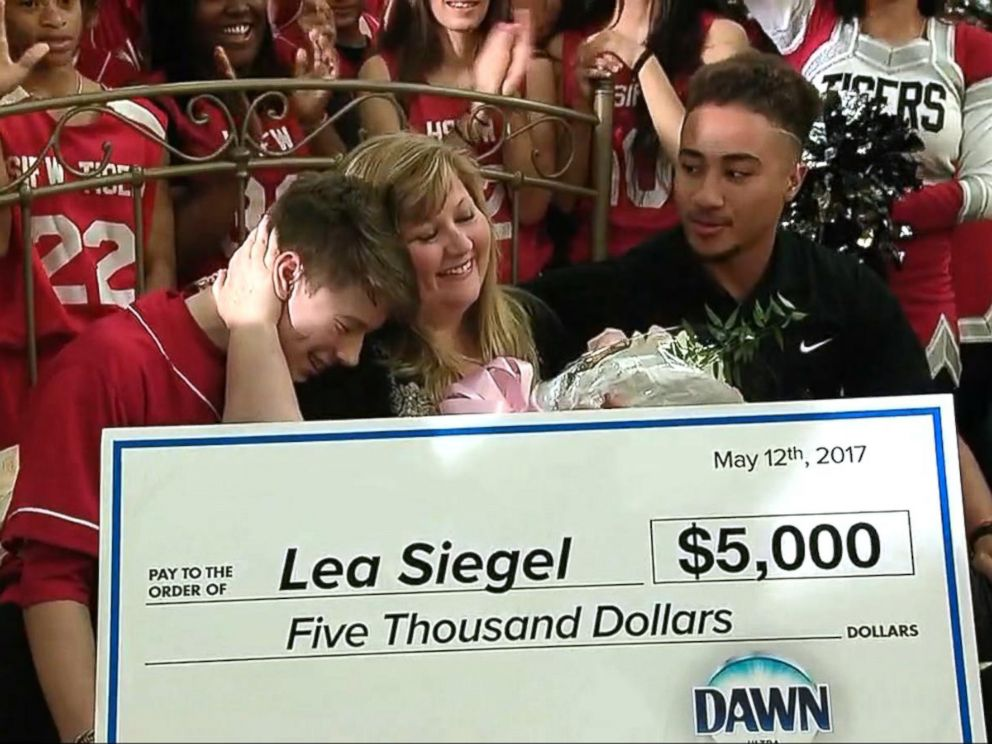 PHOTO: Emeril Lagasse named Lea Siegel, an educator from Fort Worth, Texas, the winner of his annual Breakfast in Bed search before leading her into the schools auditorium filled with students.