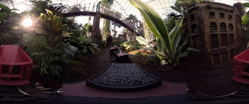 PHOTO: A model train chugs past miniature landmarks made from plant materials at the New York Botanical Garden.