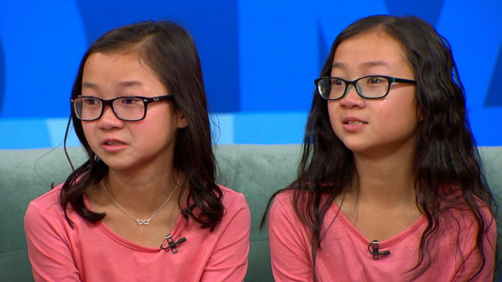 """Twins Audrey Doering and Gracie Rainsberry separated at birth meet for the first time on """"Good Morning America,"""" Jan 11, 2017."""