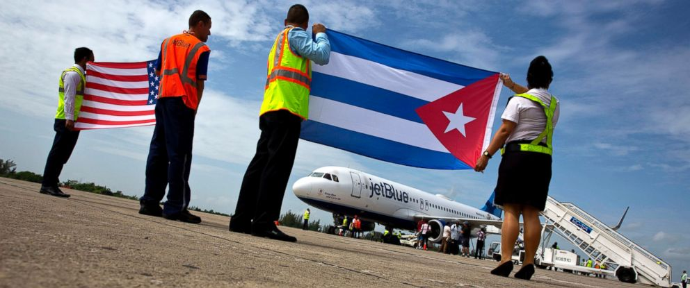 PHOTO: Airport workers receive JetBlue flight 387, the first commercial flight between the U.S. and Cuba in more than a half century, holding a United States and a Cuban national flag on the airport tarmac in Santa Clara, Cuba, Aug. 31, 2016.