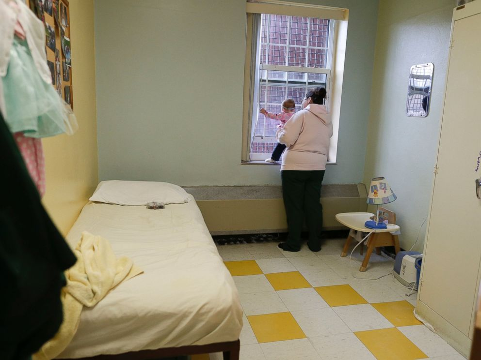 PHOTO: Jennifer Dumas looks out the window with her daughter, Codylynn, inside her room at Bedford Hills Correctional Facility, in Bedford Hills, N.Y., April 12, 2016.
