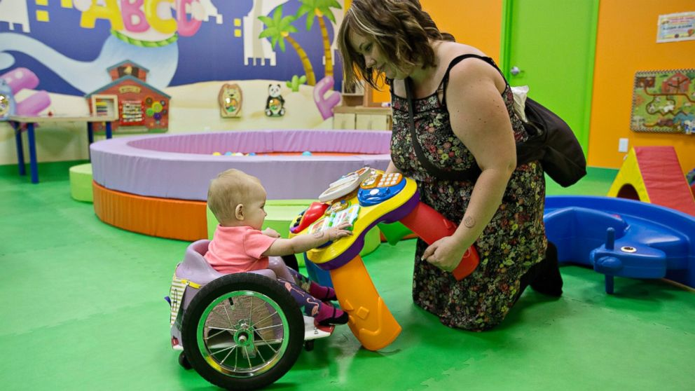 Kim Moore and her one-year-old daughter Evelyn Moore play at an indoor play ground in Edmonton Alberta, Canada, Aug. 9, 2016. Evelyn, also called Eva by her family, was diagnosed with cancer following her four-month check up.