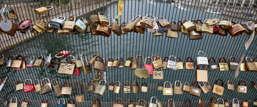 PHOTO: Love padlocks are seen on the Solferino bridge after a chunk of fencing with thousands of locks fell off under their weight on the Pont des Arts bridge, in Paris, June 9, 2014.