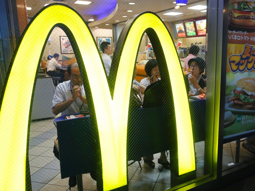 PHOTO: Customers have a meal at a McDonalds restaurant in Tokyo, July 22, 2014.