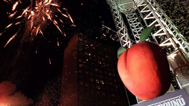PHOTO: Fireworks explode in the background as the Peach hits the bottom of the tower at Underground Atlanta to signal the beginning of the new year in Atlanta, Jan. 1, 2000.