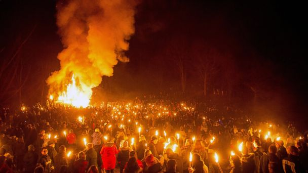 PHOTO: People stand in front of the traditional Easter bonfire with torches in their hands in Arnsberg, Germany, March 31, 2013.