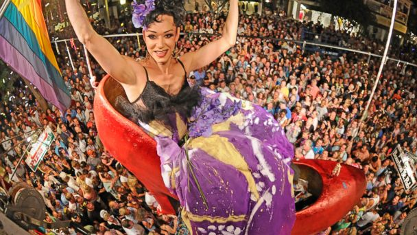 """PHOTO: In a photo released by the Florida Keys News Bureau, female impersonator Gary Marion, transformed into """"Sushi,"""" hangs above Duval Street and thousands of New Years Eve revelers at the Bourbon Street Pub Complex in Key West, Fla."""