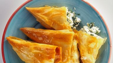 PHOTO: Boreks with feta cheese and dill on a plate.