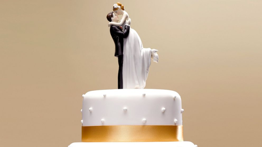 Bride and groom topper on a wedding cake.