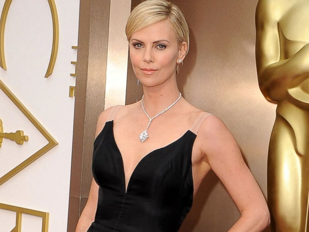 PHOTO: Charlize Theron arrives at the 86th Annual Academy Awards at Hollywood & Highland Center, March 2, 2014, in Hollywood, Calif.