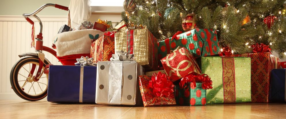 PHOTO: Many presents are seen under a Christmas tree in this stock photo.