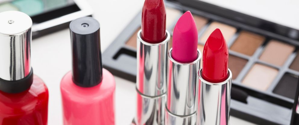PHOTO:Eye shadow, lipstick and nail polish are seen on a table in this undated file photo.