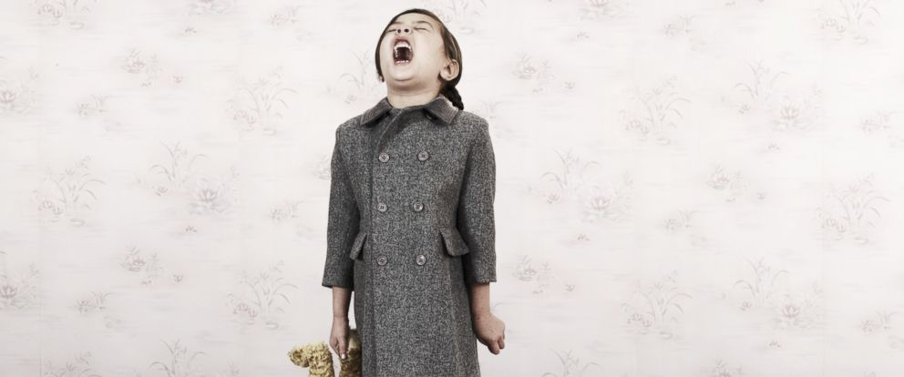 PHOTO: A girl holds part of a teddy bear and screams in this stock photo.