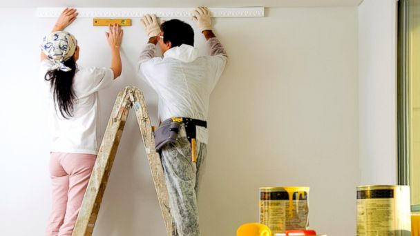 PHOTO: A couple doing some DIY home improvements.