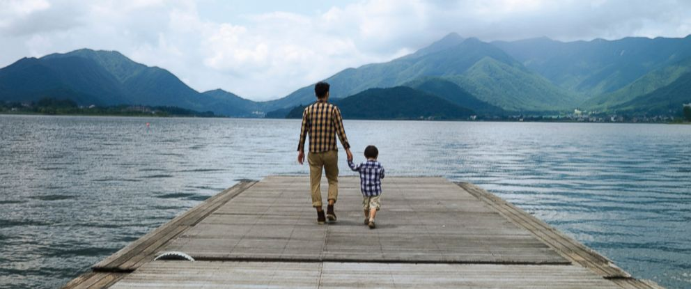PHOTO: A father and son walk on the pier overlooking a lake in this undated stock photo.