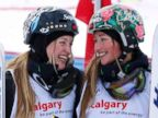 PHOTO: First place finisher Justine Dufour-Lapointe, left, and sister Chloe Dufour-Lapointe, third place,  smile at each other during the womens moguls finals at the FIS Freestyle Ski World Cup Jan. 4, 2014 in Calgary, Alberta, Canada.